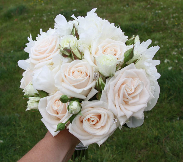 Bridal bouquet with roses and peonies