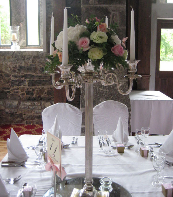 tall candelabra with roses