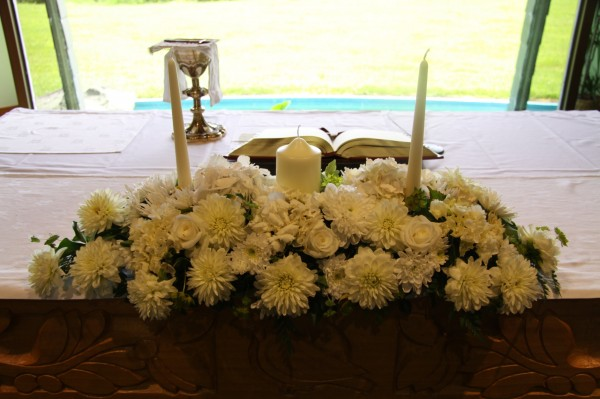 Altar flower arrangement with candles