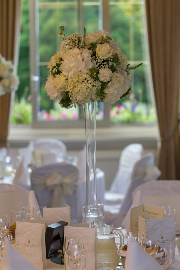 Tall centrepiece with hydrangeas and roses