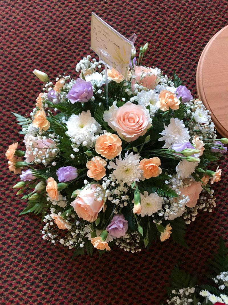 round pastel funeral wreath