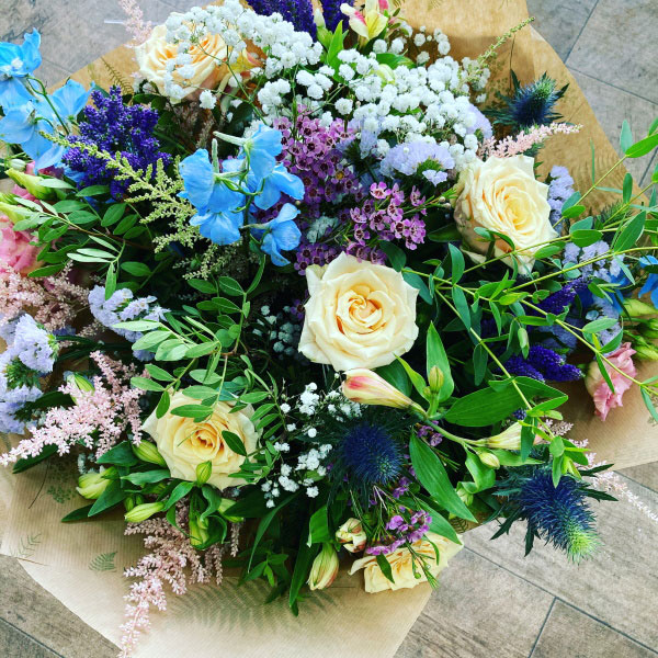 Informal Large bouquet with seasonal wildflowers garden roses and woodland greens
