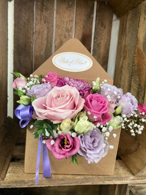 Card envelope with fresh flowers arrangement