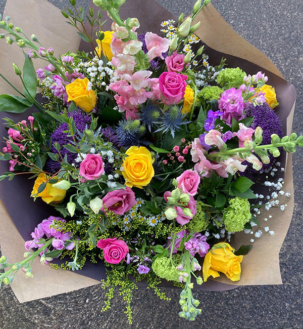 X Large bouquet filled with seasonal colourful blooms