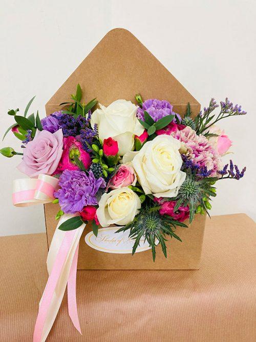 Card envelope with fresh flowers arrangement