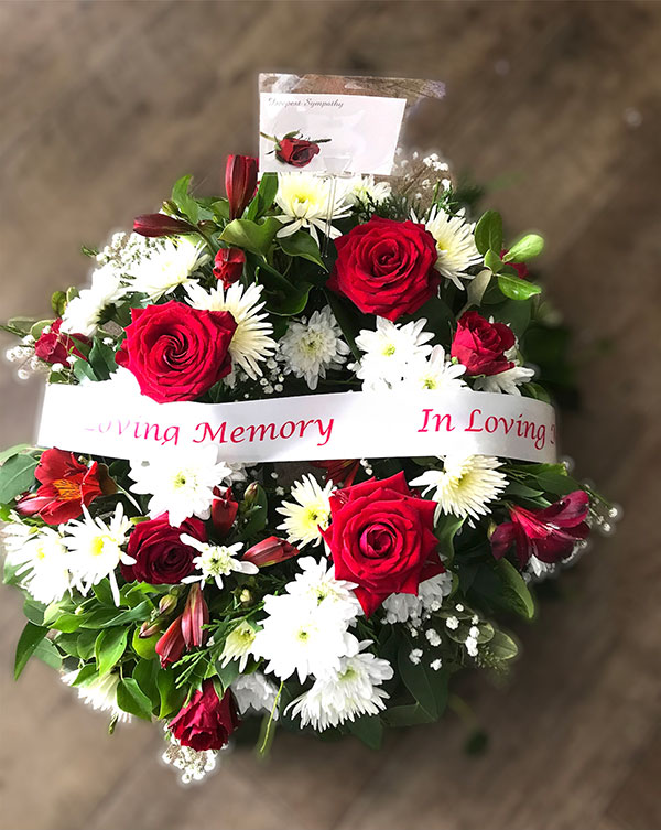 Round in loving memory wreath reds and white